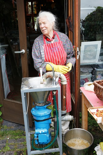 Maureen Richardson making paper using a converted waste disposal unit